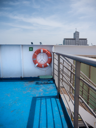 Life buoy and part of a ferry in Barcelona Port under on a sunny day 版權商用圖片