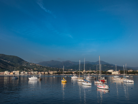 Boats in Baia delle Favole in front of Sestri Levante on a sunny day