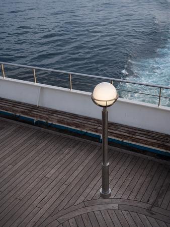 lamp post on a ferry deck at sunset 版權商用圖片