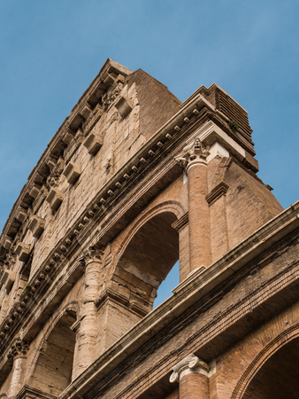 Architectural details of the Coliseum in Roma on a sunny day