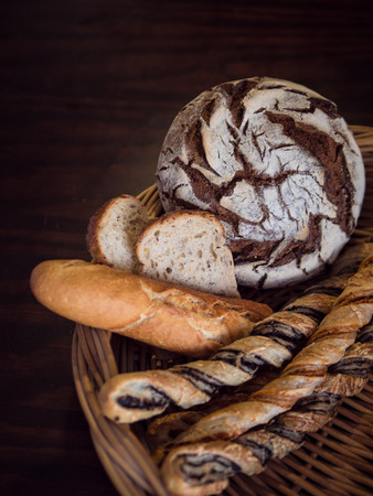 Top view of a variety of breads in a wicker basket