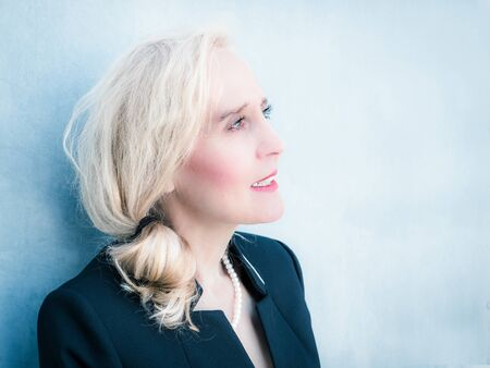 horizontal portrait of a classy mature woman looking into the future with confidence Stock Photo