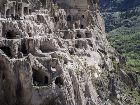 rustaveli: Vardzia cave city-monastery in Georgia  Vardzia was excavated in the Erusheti Mountain in the 12th century and is one of the main attractions of the country