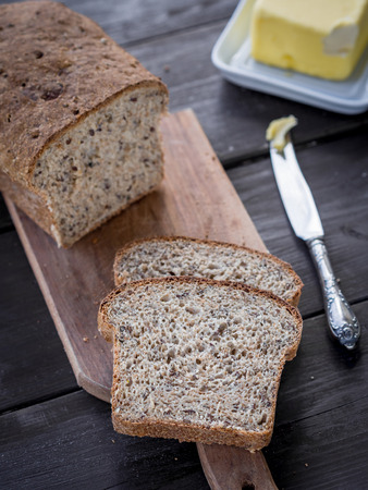 Fresh homemade whole grain wheat bread with linum and cannabis, served with butter  photo
