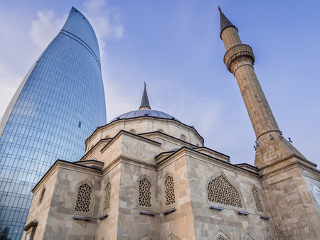 Sehidler Mescidi Mosque next to the Flame Towers in Baku, Azerbaijan