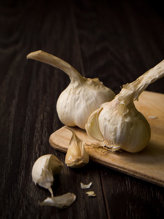 Garlic on a wooden table  photo