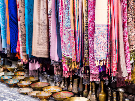 Colorful scarves and other souvenirs sold on a local market in Baku, Azerbaijan  photo