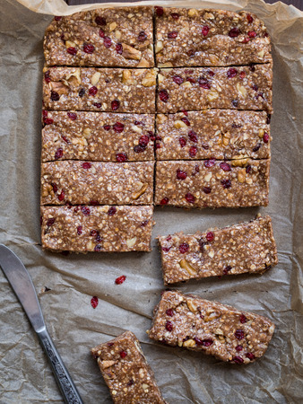 Homemade granola protein bars with peanut butter, honey, nuts and cranberries