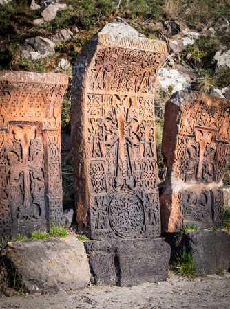 Khachkars in Sevanavank monastery, Armenia  Khachkars are a uniquely Armenian form of art and are most commonly used as tombstones, sometimes also as memorials  Stock Photo