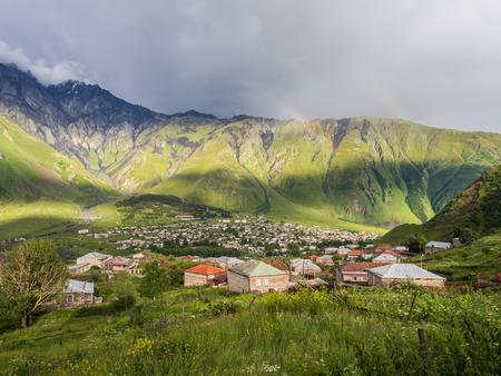 Stepantsminda  formerly Kazbegi  in Georgia, Caucasus, in the late evening  photo