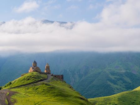 Gergeti Tsminda Sameba church near Kazbegi (Stepancminda) village, Georgia, Caucasus.