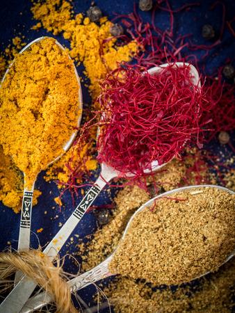 Spices from Zanzibar: turmeric, saffron and cumin on silver spoons. Stock fotó - 32314997