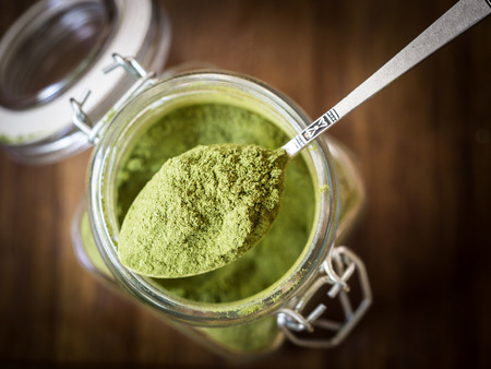 Moringa powder in a glass jar.