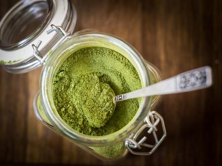 moringa: Moringa powder in a glass jar.