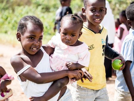 Local children asking people to take photos of them on Zanzibar island.