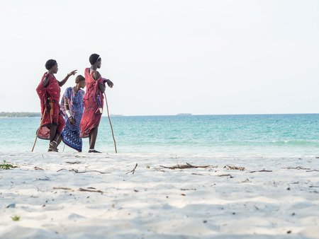 Men in traditional Masai clothes on South Beach in Dar es Salaam, the capital of Tanzania. Editorial
