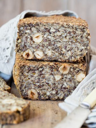 psyllium: Flourless bread with sunflower, flax and chia seeds, oats, psyllium seed husks and hazelnuts. Stock Photo