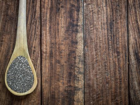 hispanica: Chia (salvia hispanica) seeds on a wooden spoon.