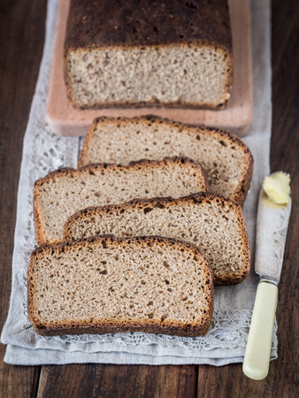 Homemade whole grain rye sourdough bread, sliced. photo