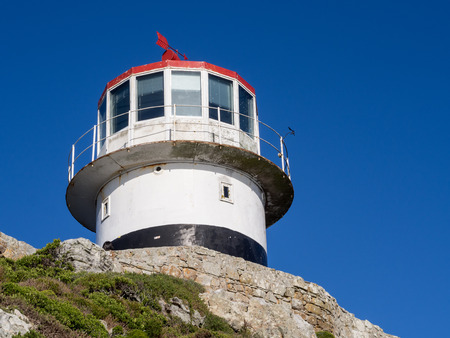 pharos: The old lighthouse at the top of Cape Point in South Africa. Stock Photo