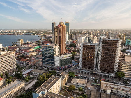Modern skyscrappers in downtown of Dar es Salaam in Tanzania, East Africa, in the evening, at sunset. Horizontal orientation.