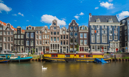 Colorful houses over a canal in Amsterdam, Netherlands. Boats in the front, blue sky in the background, landscape orientation.