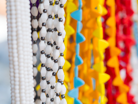 close uo: Maasai beads necklaces sold on a local Maasai market in Tanzania. Stock Photo