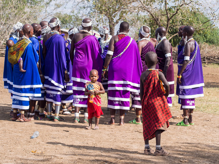 Maasai women dancing and singing during the ceremony of transition into a new age-set for young boys and girls in Tanzania.