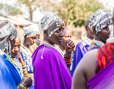 new ages: Maasai women dancing and singing during the ceremony of transition into a new age-set for young boys and girls in Tanzania.