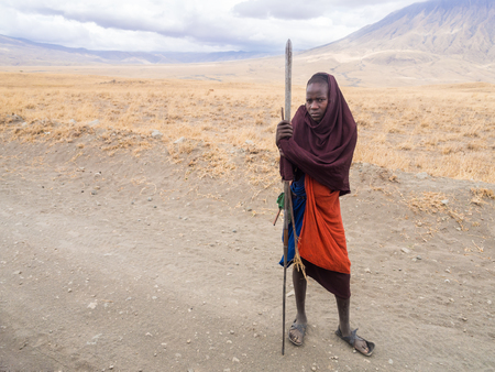 road warrior: Young Maasai warriors on the road to Lake Natron. Ol Doinyo Lengai Mountain of God in the Maasai language in the background. Editorial