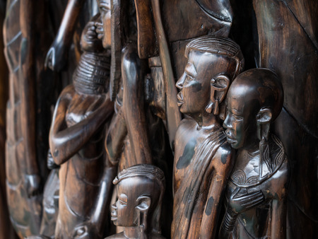 african tribe: Traditional African wood sculptures sols as souvenirs in Arusha region, Tanzania, Africa.