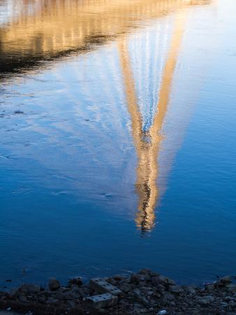 reflexion: Reflexion of the Swietokrzystki bridge in Vistula river in Warsaw, Poland.