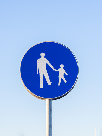 father in law: Road sign pedestrians only in Warsaw, Poland.