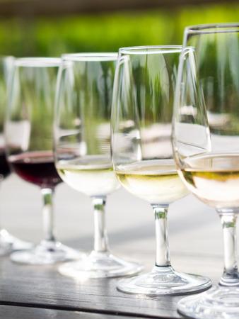 sauvignon: Wine tasting in Stellenbosch, South Africa. From the front: blanc de noir, chardonnay, sauvignon blanc, merlot, cabernet sauvignon. Stock Photo