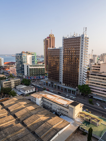 vertical orientation: Architecture in downtown of Dar es Salaam, Tanzania, East Africa, in the evening, at sunset. Vertical orientation, wide angle.