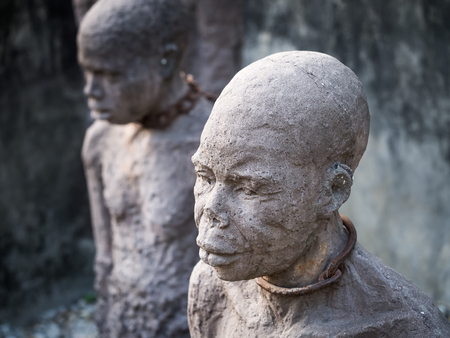 slaves: Sculpture of slaves dedicated to victims of slavery in Stone Town of Zanzibar, placed close to the former slave market.