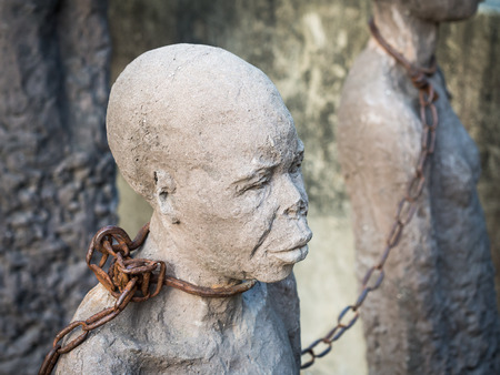 Sculpture of slaves dedicated to victims of slavery in Stone Town of Zanzibar, placed close to the former slave market.