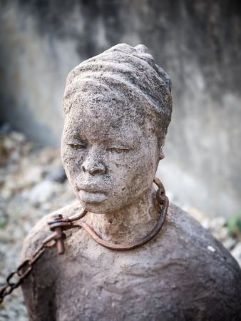 Sculpture of slaves dedicated to victims of slavery in Stone Town of Zanzibar, placed close to the former slave market. Stock fotó - 55468302