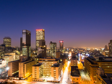 JOHANNESBURG, SOUTH AFRICA - JUNE 15, 2016: Johannesburg cityscape by night as seen from the roof of one of the buildings in the business district.