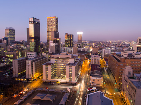 johannesburg: JOHANNESBURG, SOUTH AFRICA - JUNE 15, 2016: Johannesburg cityscape by night as seen from the roof of one of the buildings in the business district.