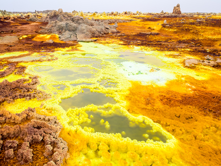 Sulphur lake Dallol in a volcanic explosion crater in the Danakil Depression, northeast of the Erta Ale Range in Ethiopia. The lake with its sulphur springs is the hottest place on Earth. Stock fotó - 63882192