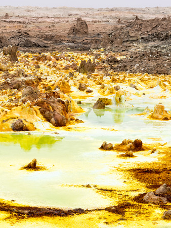 sulphur: Sulphur lake Dallol in a volcanic explosion crater in the Danakil Depression, northeast of the Erta Ale Range in Ethiopia. The lake with its sulphur springs is the hottest place on Earth.