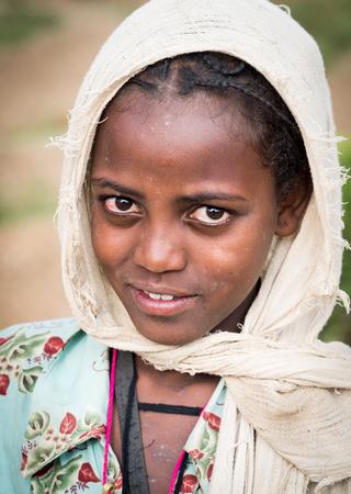 ethiopian: Portrait of a young Ethiopian girl - souvenir seller in Axum. Editorial