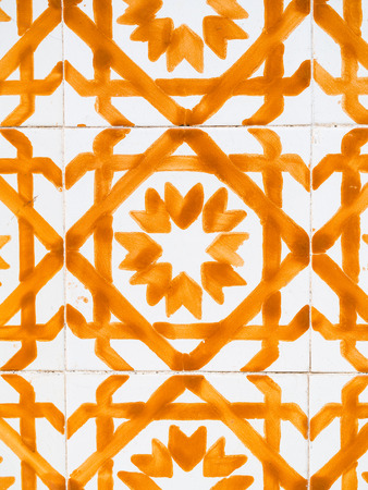 Orange azulejos, old tiles in the Old Town of Lisbon, Portugal. Stock Photo