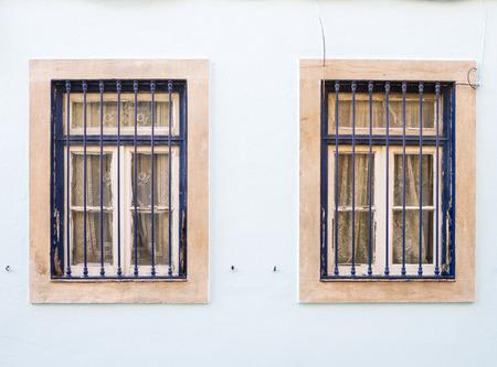 bairro: Old windows in Bairro Alto, Lisbon, Portugal.