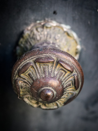 Old decorative metal door handle with ornaments in Bairro Alto, Lisbon, Portugal Stock Photo