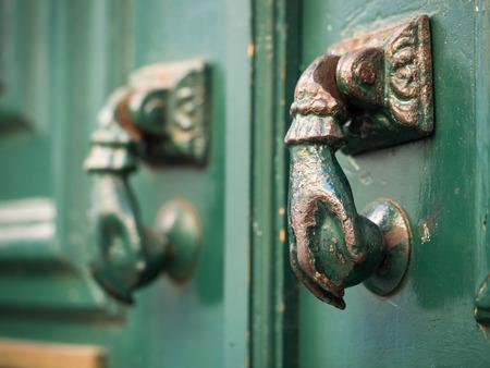 Old hand shaped metal door handles in Bairro Alto, Lisbon, Portugal
