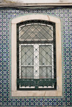 bairro: Old window in Bairro Alto, Lisbon, Portugal. Stock Photo