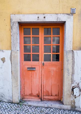 bairro: Old door in Bairro Alto, Lisbon, Portugal.