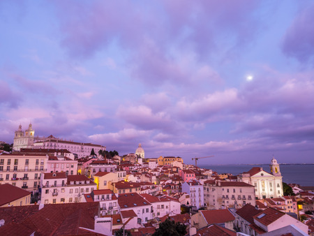 LISBON, PORTUGAL - JANUARY 10, 2017: Cityscape of Lisbon, Portugal, seen from Portas do Sol, at sunset. Editorial